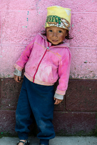 A girl at a village day care. Primeros Pasos volunteers visit village day cares to identify malneurished children