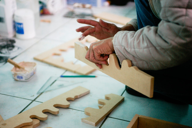 Jane supports her family by making wooden frames and mirrors