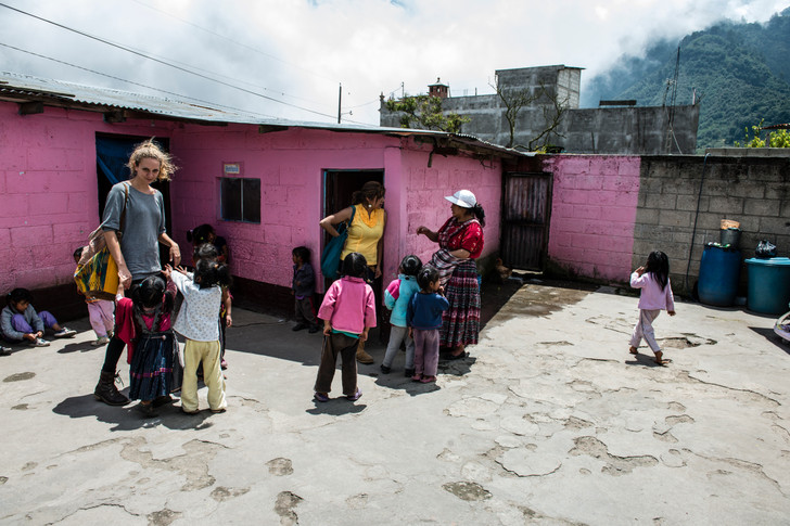 Julia, an educator and Cindy, a nuritionist, visit a village daycare as part of the nutrition program.