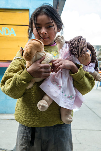 Girl with her dolls at the Edelac school.