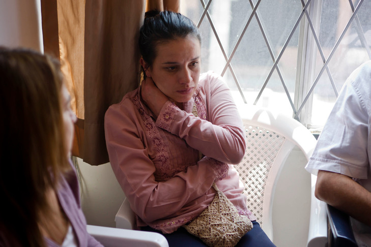 Refugee woman during consult in Quito office
