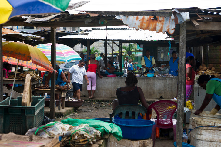 """""""Unofficial"""" market in San Lorenzo. many refugees without legal status struggle to make a living by selling different products."""
