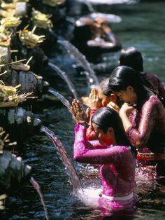 Holy water blessing at Tirta Empul.jpg