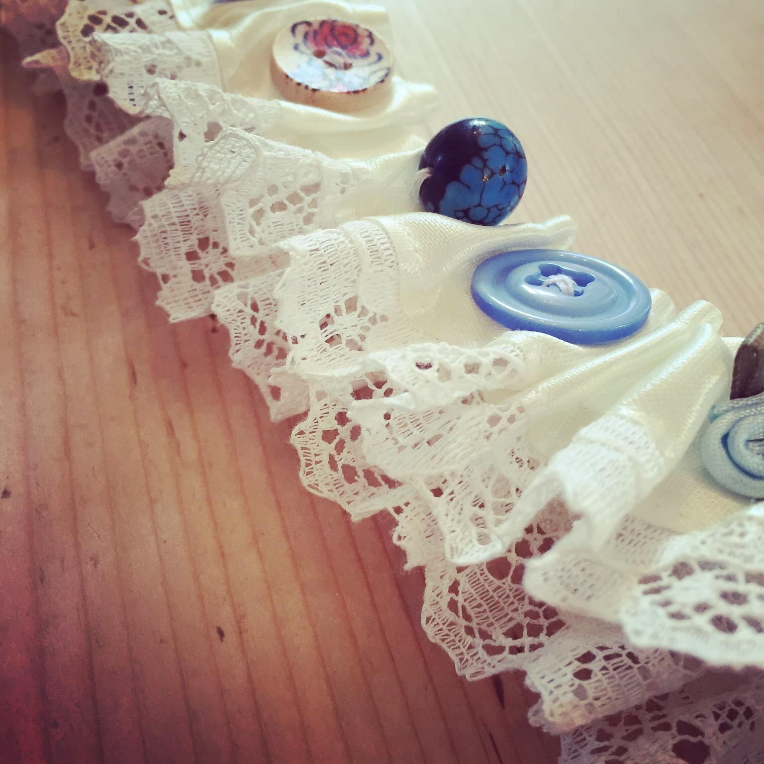 Wedding garter decorated by friends