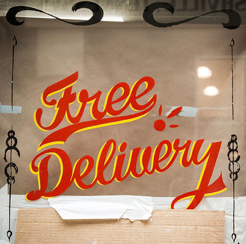 Free%20Delivery%20glass%20window%20signage_edited.jpg
