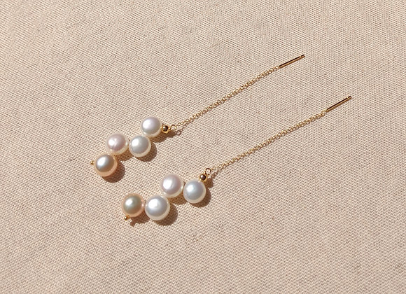 Lovely beaded string of button pearls earring