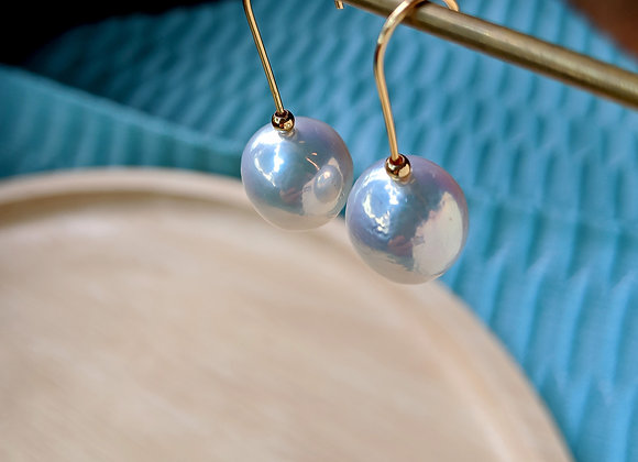 Modern hook earring with large white baroque freshwater pearl