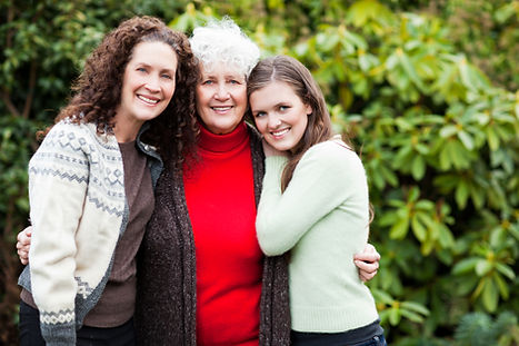 Grandmother, Daughter and Granddaughter hugging