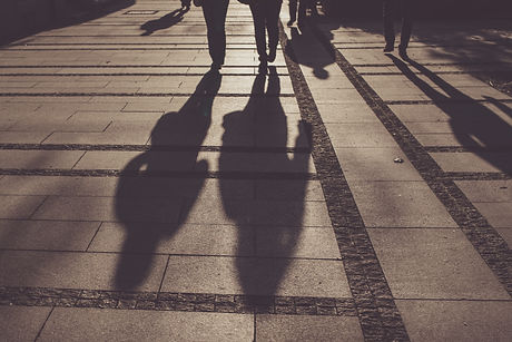 silhouettes-of-people-walking-on-city-street-PD4GER5.jpg