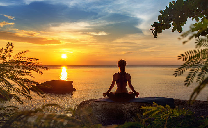 serenity and yoga practicing at sunset,m