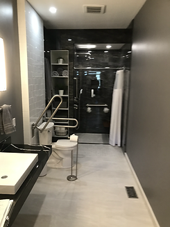 Barrier free washroom with roll-in shower