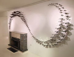 145 paper planes simultaneously hitting the wall