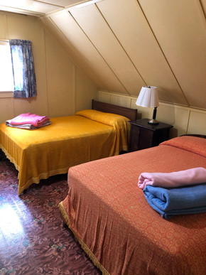 Upstairs bedroom with two full beds