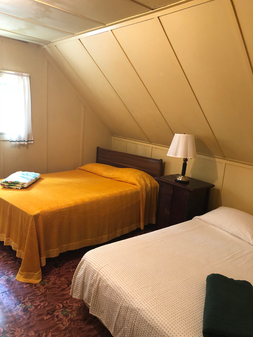 Upstairs room with two double beds