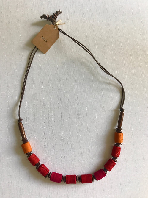 Red, pink, yellow and orange cylindrical-bead necklace on a double-strand of rec