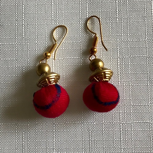 Bright pink fabric circular drop earrings with splashes of contrasting blue