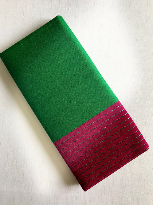 Bottle green and dark pink rectangular fabric purse with multiple pockets