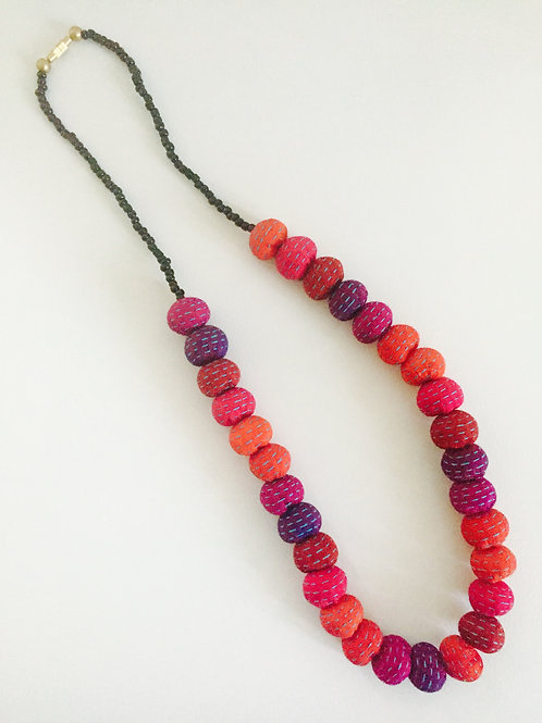 Pink, orange, burgundy and purple fabric-bead necklace, with light blue stitchin