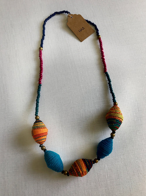 Shades of orange and peacock blue fabric-bead necklace