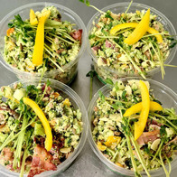 Raw brocolli, bacon salad with pumpkin s