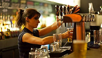 female-bartender-pouring-pint-beer.jpg