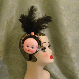 Vintage Doll face black feathered fascin