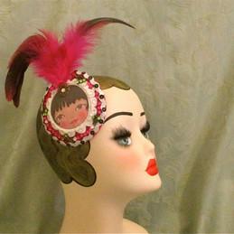 Doll face fascinator kitsch pink black