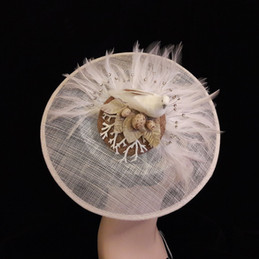 large white statement hat.