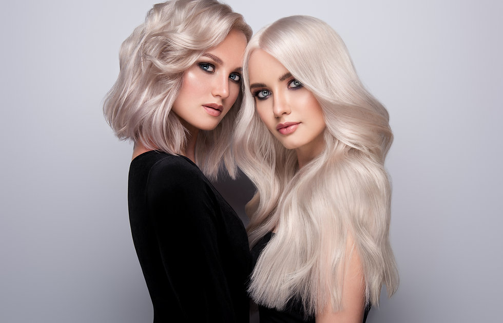 Two beautiful girls with hair coloring i