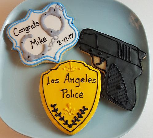 Handcuff cookies, police badge cookies, Congratulations cookies, gun cookies, police cookies Los Angeles