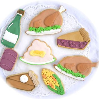 Cooked turkey cookie, pie cookie, corn on the cob cookie, cranberry cookie, wine bottle cookie, thanksgiving day cookies