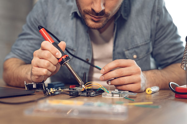 engineer-working-on-circuit-board-ML38WP