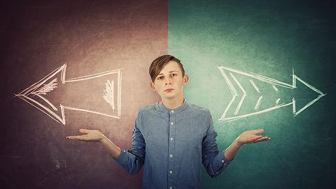 Perplexed teenage boy spread outstretche
