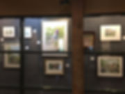 Members' artwork is displayed each month in the display case at the Anderson Arts Center.