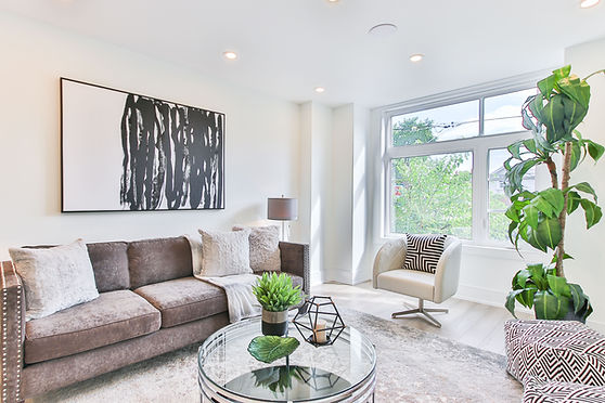 Home Staging Airdrie Calgary Living Room Brown Sofa Green Plants