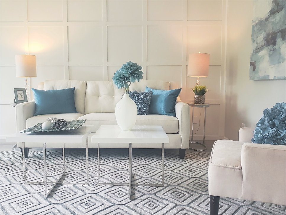 Home Staging Airdrie Calgary White sofa Blue decor