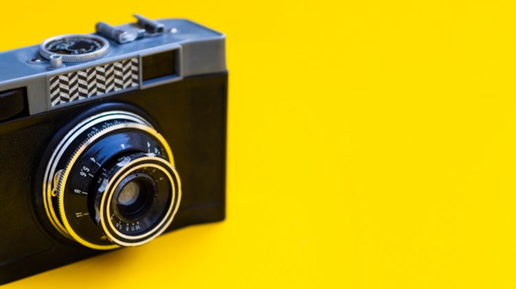 close-up-vintage-photo-camera-with-yello