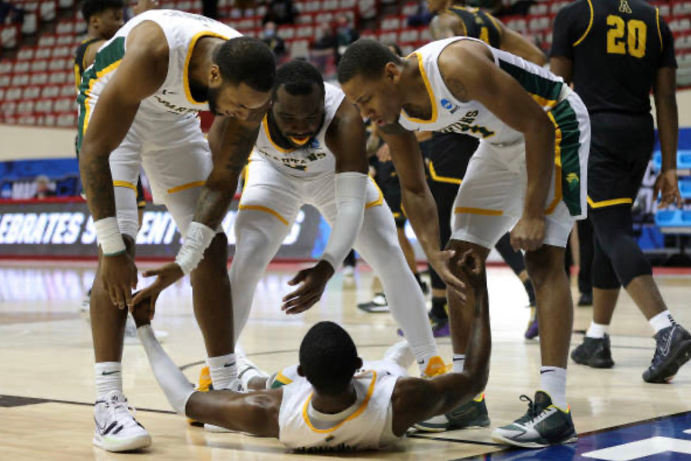 Norfolk State junior guard Jalen Hawkins gets picked up by his teammates after scoring inside and absorbing a foul. Hawkins scored a game high 24 points on 8-13 shooting