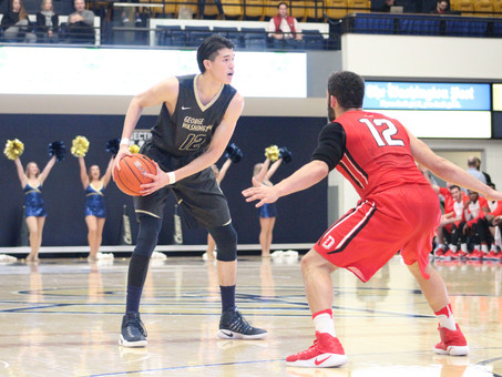 Strong Defensive Effort Helps The Colonials Edge Davidson 73-69