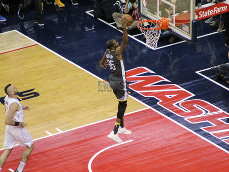 Third quarter run leads Warriors past Wizards