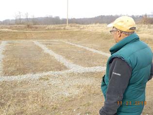 Bob Hedin Examines Future Sludge Area at Brinkerton