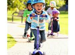 boys-having-fun-on-scooters.jpg