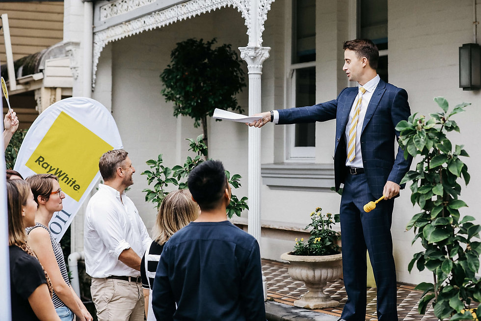 Ray White Auction with buyers at the house front.jpg