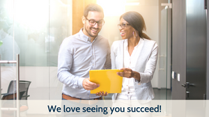 "Two business people smiling looking at a piece of paper. Bright and colorful photo captioned: ""We love seeing you succeed!"""