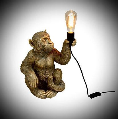 Lampe singe dorée.
