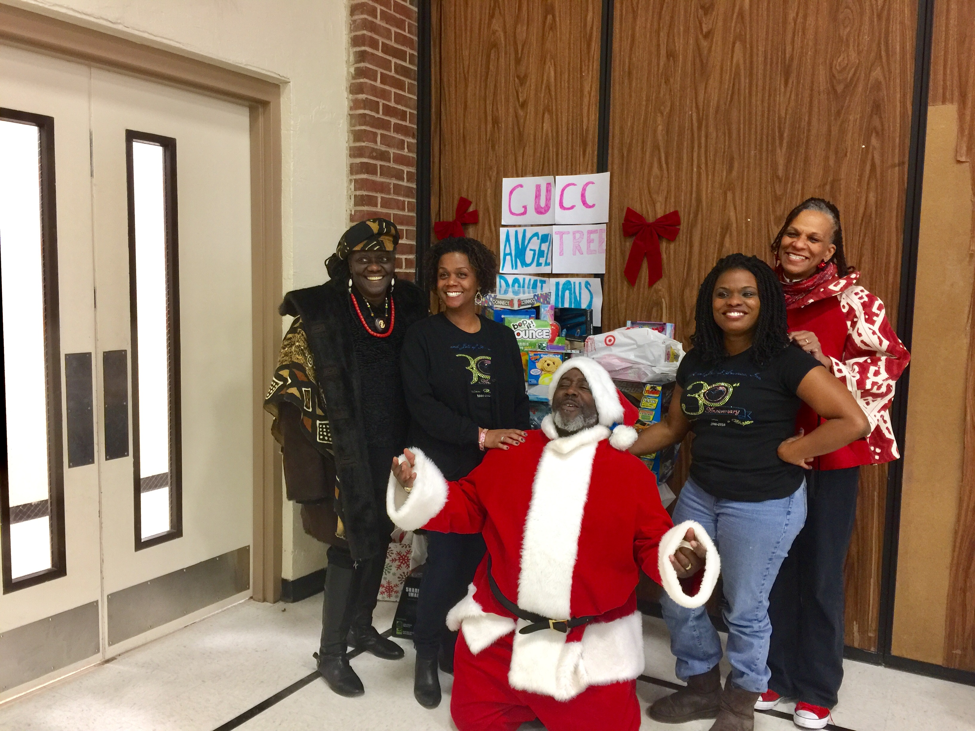Santa and representatives from Fountain Baptist Church pose for a photo