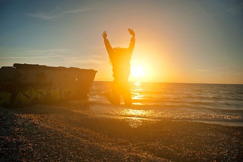 Canva - Person Jumping on Seashore durin