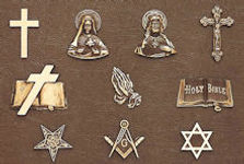 Some of the bronze religious emblems available for personalization of crypt fronts at Twin Valley Mausoleum