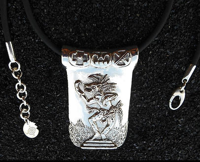 Jaguar Shaman Pendant by Savanna Redman, close up of the glyphs along the top bead.