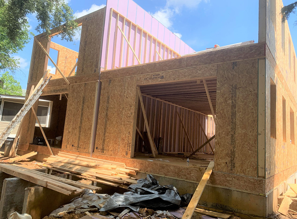 SIPs framing in progress at SYMBI Duplex One. Image of exterior wall.